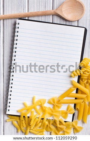 the blank recipe book with various pasta - stock photo