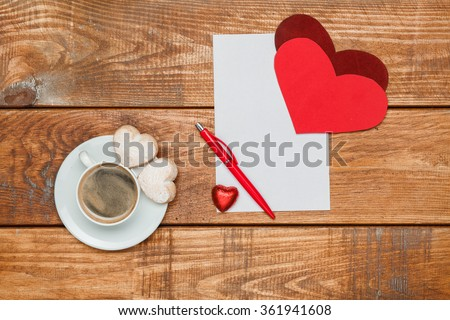 The blank sheet of paper and pen with  hearts   - stock photo