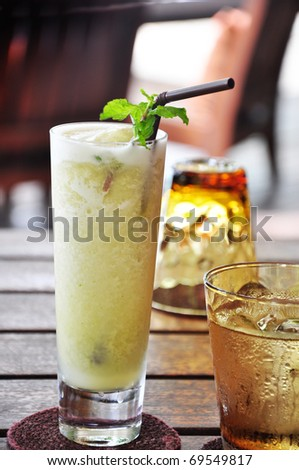 the blended mixed fruit called mint paradise smoothy - stock photo