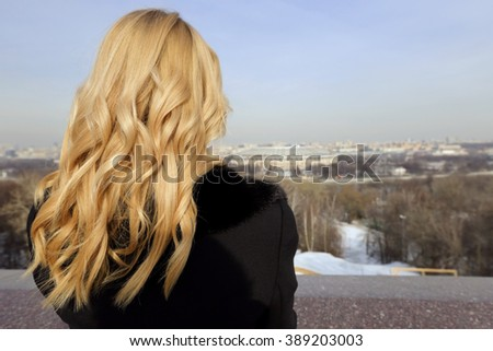 The blonde girl on the observation deck in Moscow in winter