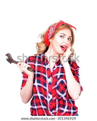 The blonde holds a wrench on a white background - stock photo