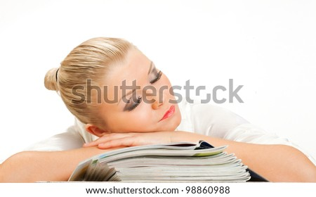 The blonde sleeps on a pack of glossy magazine on white background isolated - stock photo
