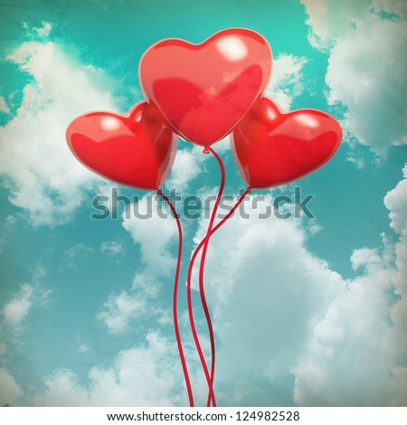 The blue cloudy sky with balloons, as valentines background