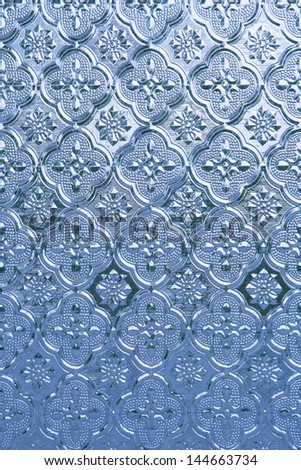 The blue color of the glass is a beautiful backdrop. - stock photo
