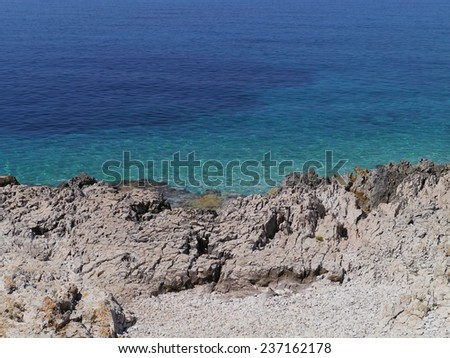 The blue colors of the Adriatic sea at the coast of Veli Rat on the Island Dugi Otok in Croatia - stock photo