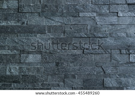 The blue grey color of rough brick block wall; Background textures - stock photo