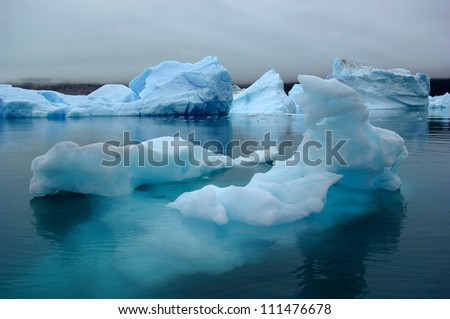 The Blue Icebergs of Narsarsuaq Greenland originating from the Qooroq Glacier - stock photo