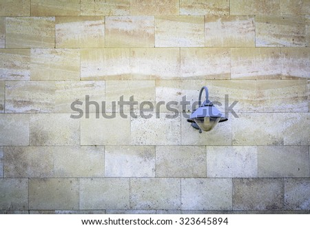 The blue lamp on the brick wall - stock photo