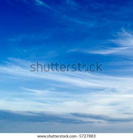 The blue sky and beautiful white clouds. - stock photo