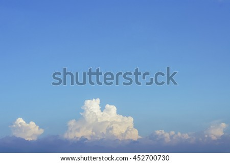 The blue sky and white cloud in the sunny day - stock photo