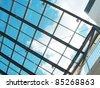 The blue sky through a glass ceiling - stock photo