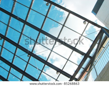 The blue sky through a glass ceiling - stock photo
