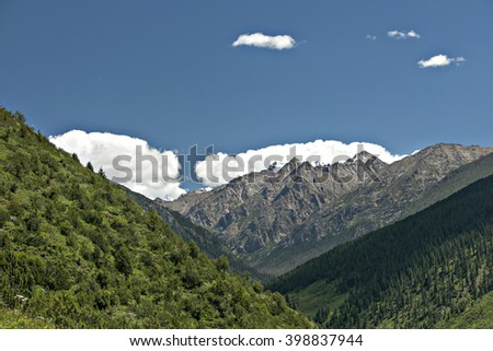 the blue sky with white cloud and blue mountain in summer sunshine. - stock photo