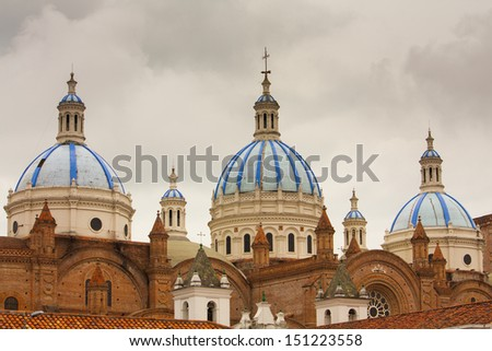 The blue tiled domes of Cathedral of the Immaculate Conception in Cuenca Ecuador which is also known as the New Cathedral. - stock photo