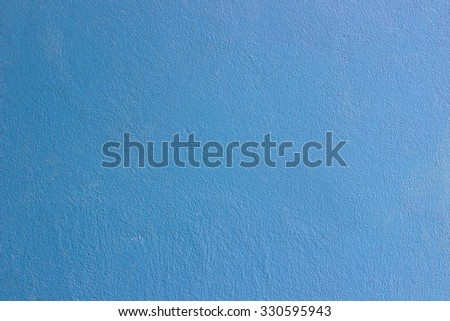 The blue wall background.
