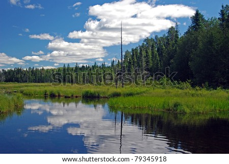 The blue water and blue skies in Fran lake in the Quetico wilderness