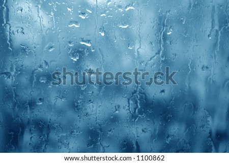 The blues. Window glass in a rainy day.