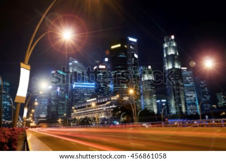 The blurred of beauty of car lights and street lighting with lens flare effect at night on the road in the city.