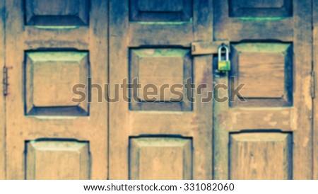 The blurry old grunge folding doors locked, retro style. - stock photo