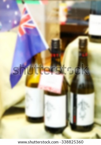 The blurry photo of wine shop scene background represent the wine and liquor business concept related idea. - stock photo