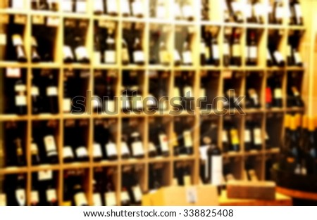 The blurry photo of wine shop scene background represent the wine and liquor business concept related idea.