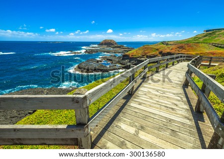 The boardwalks outside The Nobbies center overlook Seal Rocks. Grant Point, western tip of Phillip Island, Victoria, Australia. - stock photo