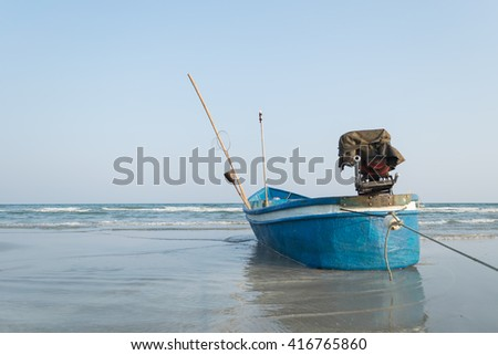 The Boat fishing on the beach