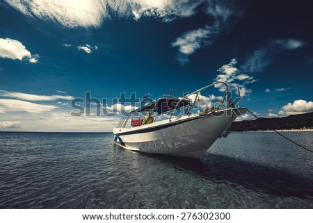 The boat near the shore. - stock photo