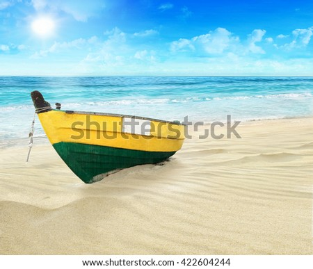 The boat on the shore. - stock photo