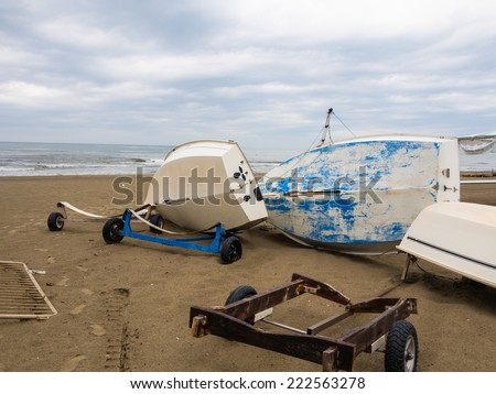 The boat overturned on the beach for wind storm - stock photo
