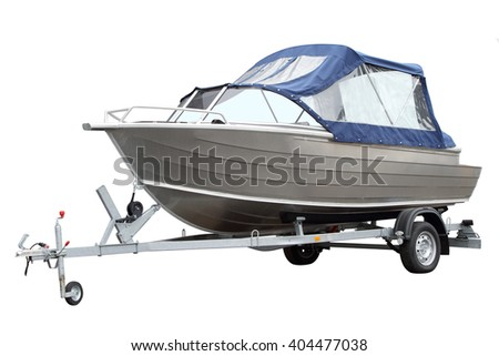 The boat with the tent loaded on a trailer for transportation. - stock photo