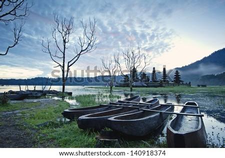 The boats and Temple of Lake Tamblingan, Bali, Indonesia - stock photo