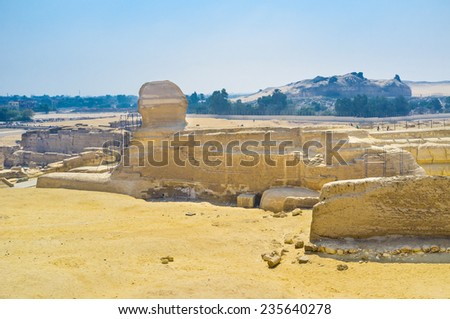 The body of a lion with the head of a king or god, the Great Sphinx has come to symbolize strength and wisdom, Giza, Egypt. - stock photo