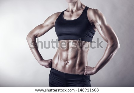 The body sports an attractive woman on gray background - stock photo