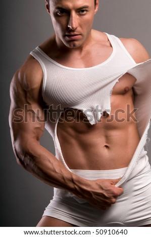 The bodybuilder rending  his underwear. - stock photo