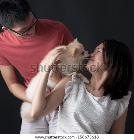 The bond between the pet and its owners - stock photo