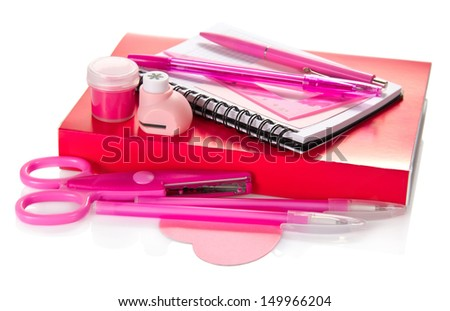 The book, a notepad, handles, scissors, a puncher and paint isolated on white