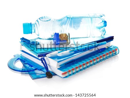 The book, notepad, pencil-case, stationery and bottle with the water, isolated on white