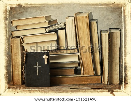 The book of Catholic Church liturgy and rosary beads/ Old holy bible - stock photo