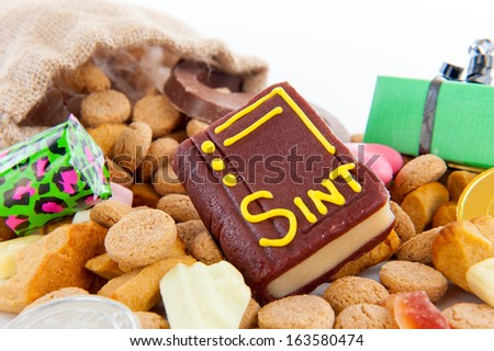 "The book of Sinterklaas and a lot of pepernoten, for celebrating a dutch holiday "" Sinterklaas ""  on the fifth of December - stock photo"