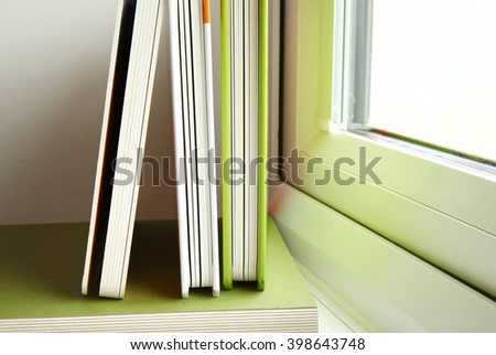 The books put beside the house window represent the concept related idea.