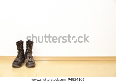 The boots on the floor - stock photo