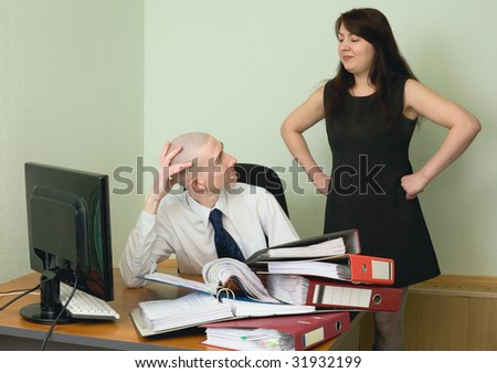 The boss and the secretary on a workplace at office - stock photo