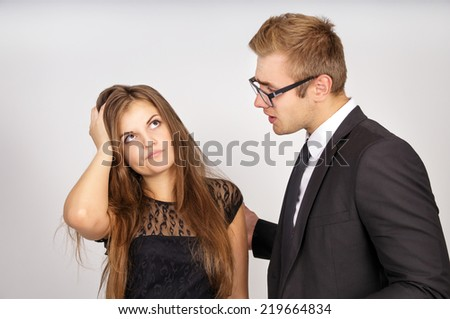 The boss is not satisfied with the work young of subordinate, on a gray background - stock photo
