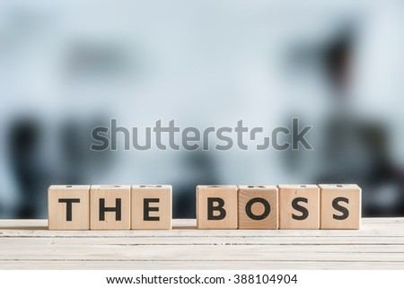 The boss sign on a wooden office desk - stock photo