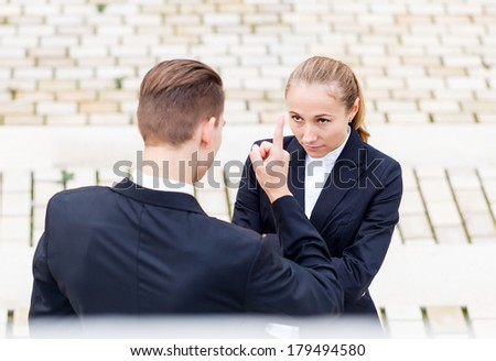The boss threatened his employee because she late - stock photo