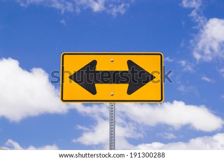 "The ""Both Ways"" sign in the Southern California desert. - stock photo"