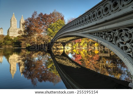 The Bow Bridge  is a cast iron bridge located in Central Park, New York City, crossing over The Lake and used as a pedestrian walkway,autumn - stock photo
