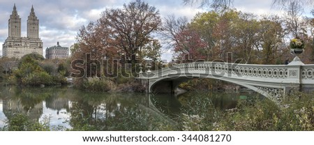 The Bow Bridge  is a cast iron bridge located in Central Park, New York City, crossing over The Lake  - stock photo