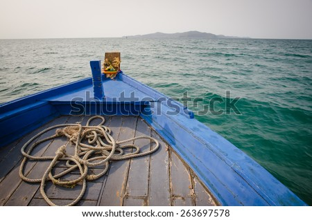 the bow of a blue boat - stock photo